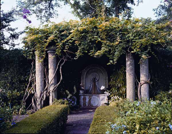 Pergola with wisteria and mercer fountain